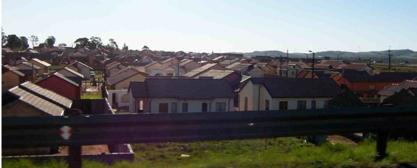 Township roofs on the way to J/burg. Far better in this one than Cape Flats.