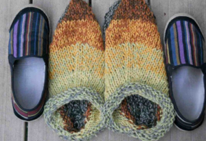 Clogs unfelted, sitting hugely between a pair of my shoes.