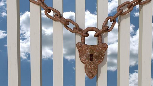 lock chain white fence sky.jpg