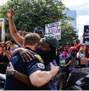cop hug 1